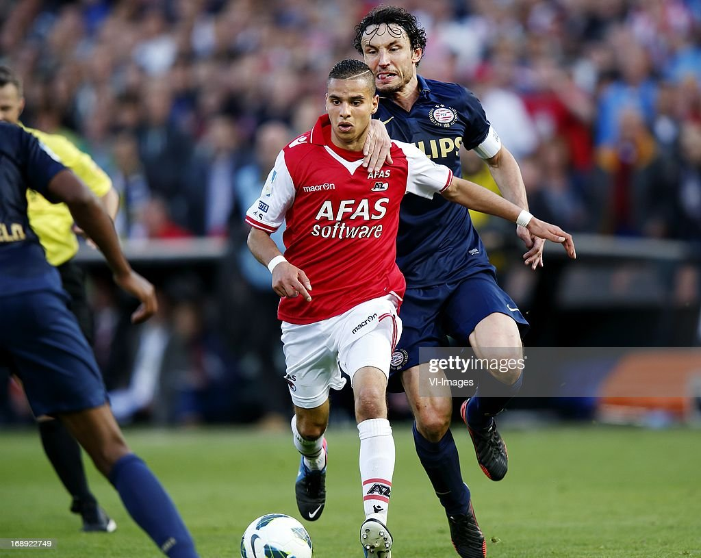 Adam Maher (L), Mark van Bommel (R) during the Dutch Cup final match between AZ Alkmaar and PSV Eindhoven on May 9, 2013 at the Kuip stadium in Rotterdam, The Netherlands.