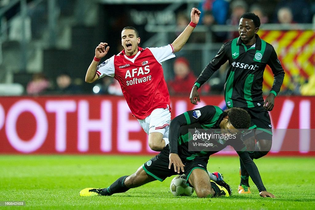 Adam Maher of AZ, Virgil van Dijk of FC Groningen, Oluwafemi Ajilore of FC Groningen during the Dutch Eredivisie match between AZ Alkmaar and FC Groningen at the AFAS Stadium on february 2, 2013 in Alkmaar, The Netherlands