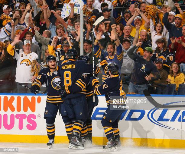 Adam Mair of the Buffalo Sabres celebrates his goal with teammates Andrej Sekera Nathan Gerbe and Cody McCormick during the first period against the...