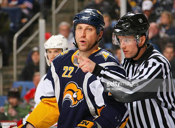Adam Mair of the Buffalo Sabres is directed by linesman Steve Barton in a game with the New Jersey Devils on April 4 2009 at HSBC Arena in Buffalo...
