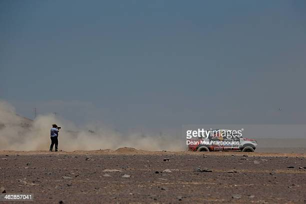 Adam Malysz and Rafal Marton of Poland for Proto Overdrive Toyota compete in stage 10 on the way to Antofagasta during Day 11 of the 2014 Dakar Rally...