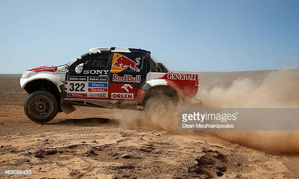 Adam Malysz and Rafal Marton of Poland for Proto Overdrive Toyota compete in stage 11 on the way to El Salvador during Day 12 of the 2014 Dakar Rally...