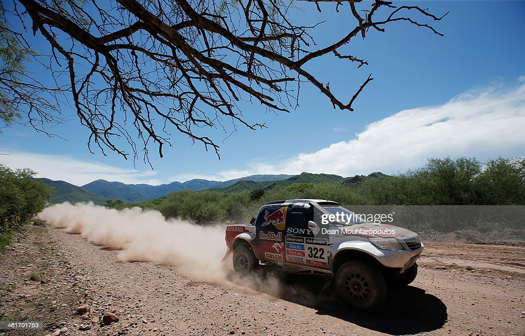 Adam Malysz and Rafal Marton of Poland for Proto Overdrive Toyota compete during Day 6 of the 2014 Dakar Rally on January 10, 2014 near Embalse Cabra Corral, Argentina.