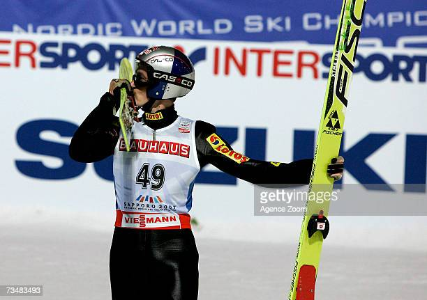 Adam Malysz celebrates placing first during the FIS Nordic World Ski Championships Ski Jumping HS 100 event on March 3 2007 in Sapporo Japan