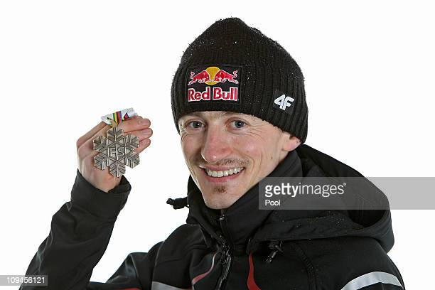 Adam Malysz of Austria poses with the bronze medal won in the Men's Ski Jumping HS106 competition during the FIS Nordic World Ski Championships at...