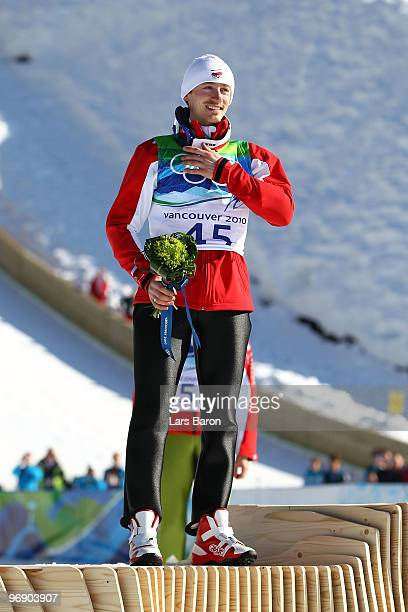 Adam Malysz of Poland celebrates after winning the Silver medal on the Large Hill during day 9 of the 2010 Vancouver Winter Olympics at Ski Jumping...