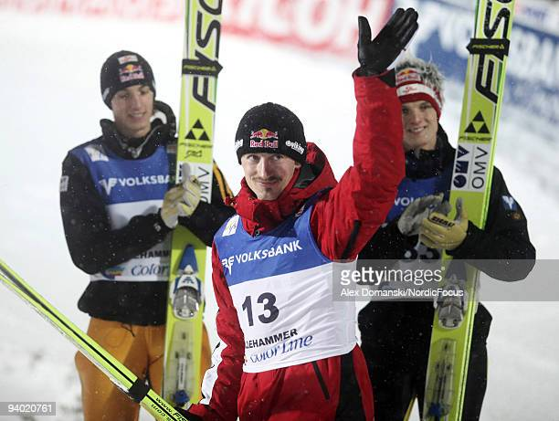 Adam Malysz of Poland celebrates the third place in the Ski Jumping HS 138 event during day one of the FIS World Cup on December 5 2009 in...