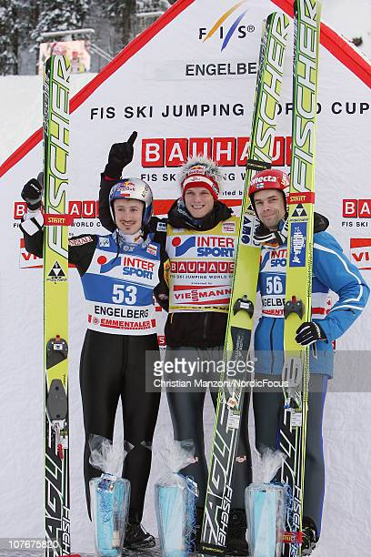 Adam Malysz of Poland celebrates with Thomas Morgenstern of Austria and Matti Hautamaeki of Finland after the individual HS137 during the FIS Ski...