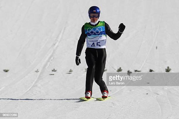 Adam Malysz of Poland comes to a landing after jumping the Large Hill on day 9 of the 2010 Vancouver Winter Olympics at Ski Jumping Stadium on...