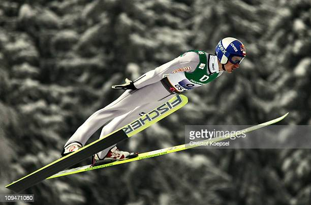 Adam Malysz of Poland competes in the Men's Ski Jumping Team HS106 competition during the FIS Nordic World Ski Championships at Holmenkollen on...