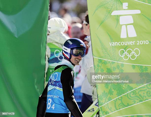 Adam Malysz of Poland looks on during the men's ski jumping team event on day 11 of the 2010 Vancouver Winter Olympics at Whistler Olympic Park Ski...