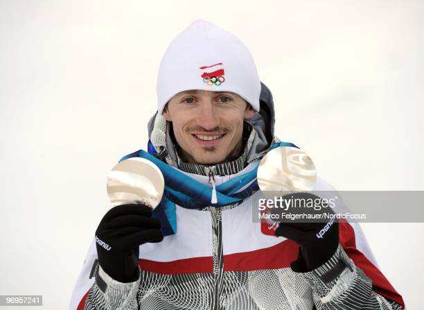 Adam Malysz of Poland presents his silver medals of the normal hill and large hill competions at the Olympic Winter Games Vancouver 2010 biathlon on...