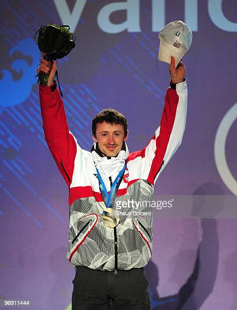 Adam Malysz of Poland receives the silver medal during the medal ceremony for the men's large hill individual ski jumping held at the Whistler Medals...