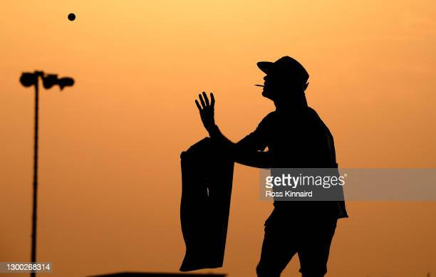 Adam Marrow, caddie of Thomas Pieters of Belgium catches a ball on the 11th hole during Day One of the Saudi International powered by SoftBank...
