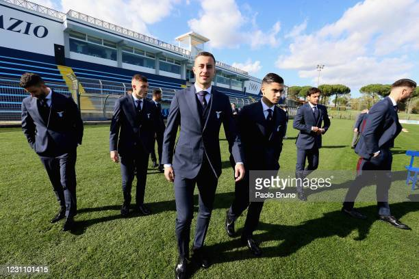 Adam Marusic and Andreas Pereira look on during the SS Lazio official team photo at Formello Sport Centre on February 11, 2021 in Rome, Italy.