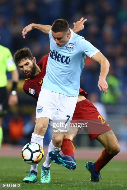 Adam Marusic of Lazio and Federico Fazio of Roma during the serie A match between SS Lazio and AS Roma at Stadio Olimpico on April 15 2018 in Rome...