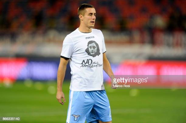 Adam Marusic of Lazio wears a shirt depicting Anne Frank saying 'no to antiSemitism' in response to antisemitic graffiti left by their fans at a...