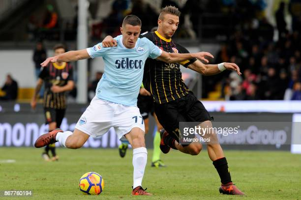 Adam Marusic of SS Lazio compete for the ball with Gianluca Di Chiara of Benevneto Calcio during the Serie A match between Benevento Calcio and SS...