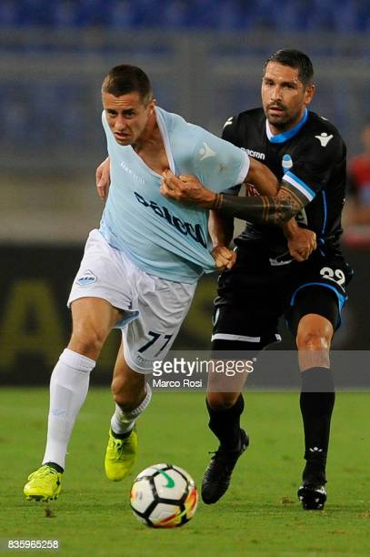 Adam Marusicof SS Lazio compete for the ball with Marco Borriello of Spal during the Serie A match between SS Lazio and Spal at Olimpico Stadium on...