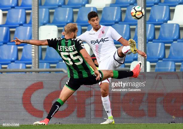 Adam Masina of Bologna FC competes for the ball whit Timo Letschert of US Sassuolo during the Serie A match between US Sassuolo and Bologna FC at...