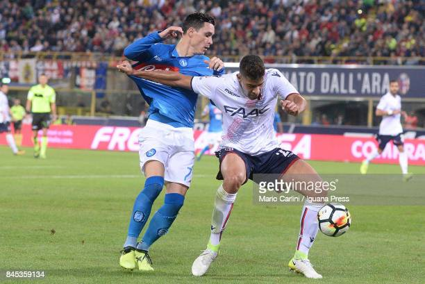 Adam Masina of Bologna FC competes the ball with Jos Callejon of SSC Napoli during the Serie A match between Bolgna FC and SSC Napoli at Stadio...