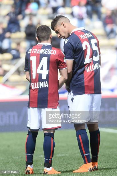 Adam Masina of Bologna FC talks to his team mate Federico Di Francesco during the serie A match between Bologna FC and AS Roma at Stadio Renato...