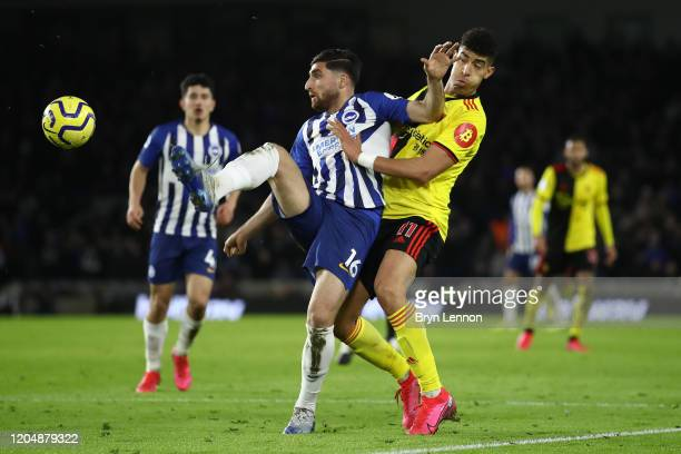 Adam Masina of Watford battles for possession with Alireza Jahanbakhsh of Brighton and Hove Albion during the Premier League match between Brighton...