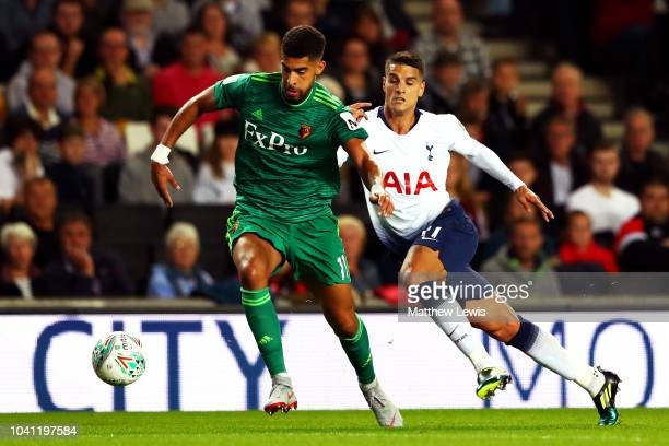 Adam Masina of Watford battles for possession with Erik Lamela of Tottenham Hotspur during the Carabao Cup Third Round match between Tottenham...