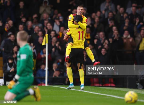 Adam Masina of Watford celebrates with Gerard Deulofeu of Watford after scoring his team's first goal during the Premier League match between Watford...