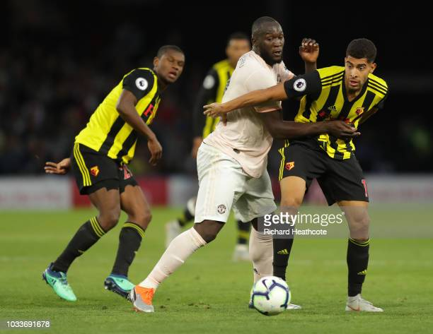 Adam Masina of Watford challenges for the ball with Romelu Lukaku of Manchester United during the Premier League match between Watford FC and...