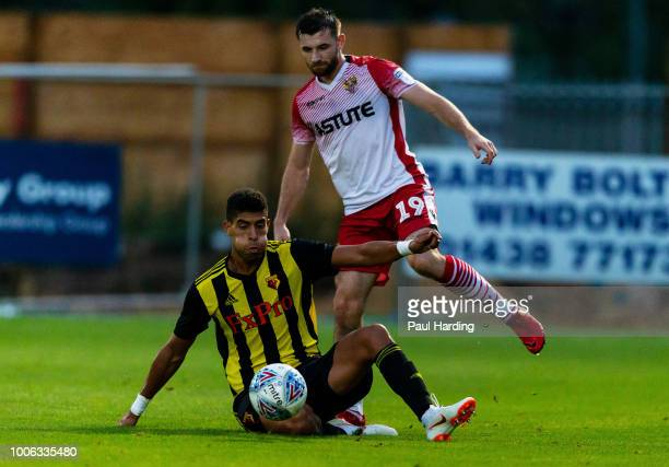 Adam Masina of Watford FC and Danny Nugent of Stevenage at The Lamex Stadium on July 27 2018 in Stevenage England