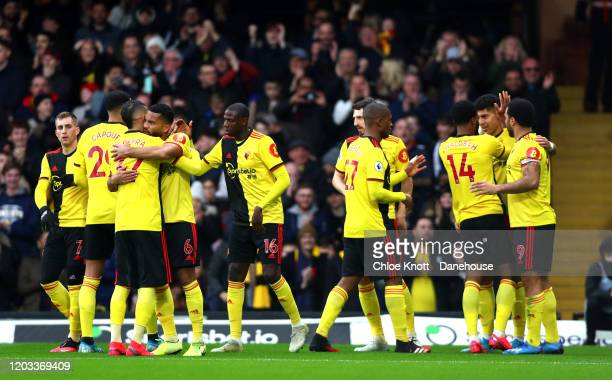 Adam Masina of Watford FC celebrates scoring his teams first goal during the Premier League match between Watford FC and Everton FC at Vicarage Road...