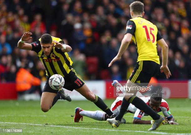 Adam Masina of Watford is challenged by Michy Batshuayi of Crystal Palace during the FA Cup Quarter Final match between Watford and Crystal Palace at...