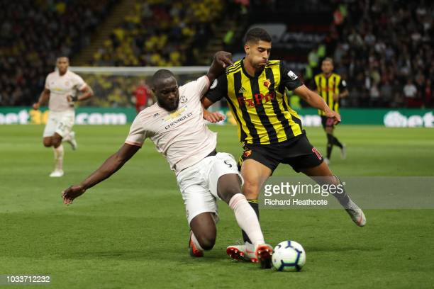 Adam Masina of Watford is challenged by Romelu Lukaku of Manchester United during the Premier League match between Watford FC and Manchester United...