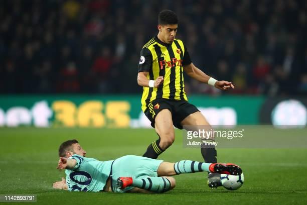 Adam Masina of Watford is tackled by Shkodran Mustafi of Arsenal during the Premier League match between Watford FC and Arsenal FC at Vicarage Road...