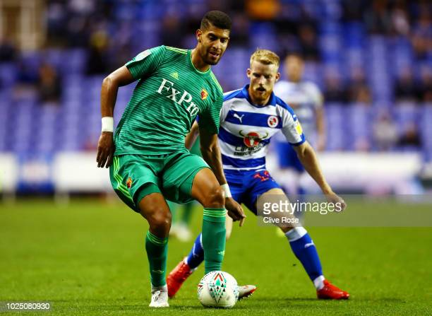 Adam Masina of Watford passes the ball under pressure from Joshua Sims of Reading during the Carabao Cup Second Round match between Reading and...