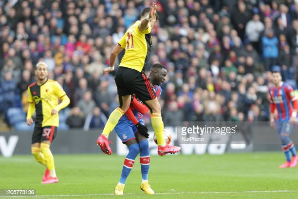 Adam Masina of Watford tackling Cheikhou Kouyate of Crystal Palace during the Premier League match between Crystal Palace and Watford at Selhurst...