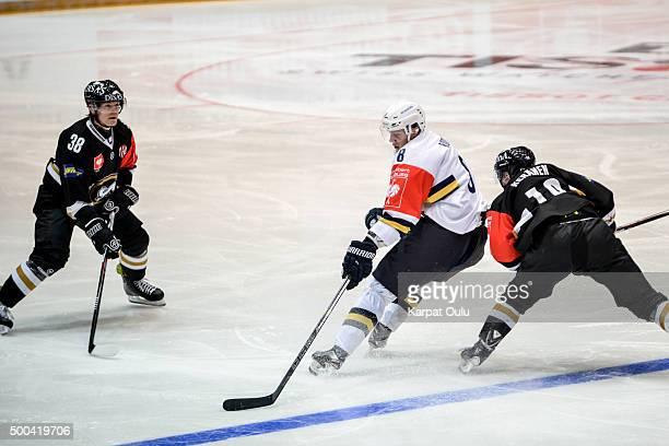 Adam Masuhr and Juho Keranen of Karpat Oulu defending against Robert Rooba of Espoo Blues during the Champions Hockey League quarter final between...