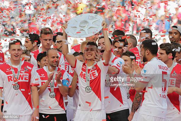 Adam Matuschyk of Cologne lifts the trophy after winning the Second Bundesliga title at RheinEnergieStadion on May 4 2014 in Cologne Germany