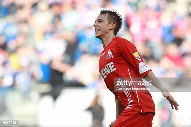 Adam Matuschyk of Koeln celebrates scoring his second team goal during the Bundesliga match between 1899 Hoffenheim and 1 FC Koeln at RheinNeckar...
