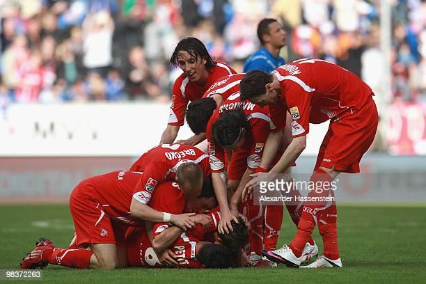 Adam Matuschyk of Koeln celebrates scoring his second team goal with his team mates during the Bundesliga match between 1899 Hoffenheim and 1 FC...