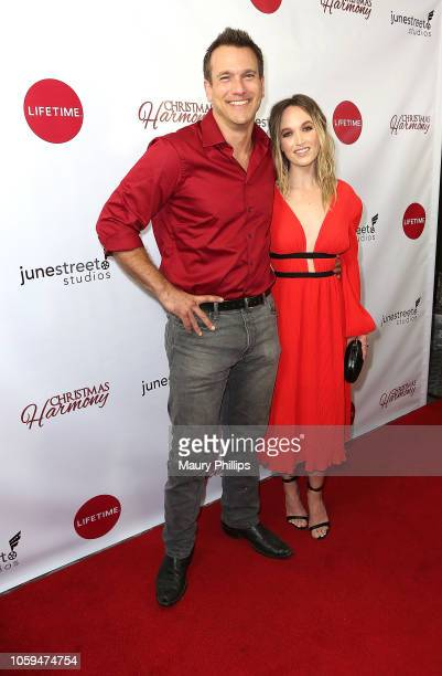 Adam Mayfield and Kelly Jakie arrive at Lifetime's Christmas Harmony Premiere at Harmony Gold Theater on November 7 2018 in Los Angeles California