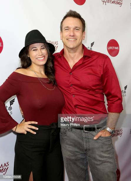 Adam Mayfield and Virginia Novello arrive at Lifetime's Christmas Harmony Premiere at Harmony Gold Theater on November 7 2018 in Los Angeles...