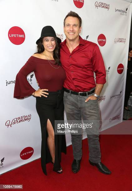 """Adam Mayfield and Virginia Novello arrive at Lifetime's """"Christmas Harmony"""" Premiere at Harmony Gold Theater on November 7, 2018 in Los Angeles,..."""