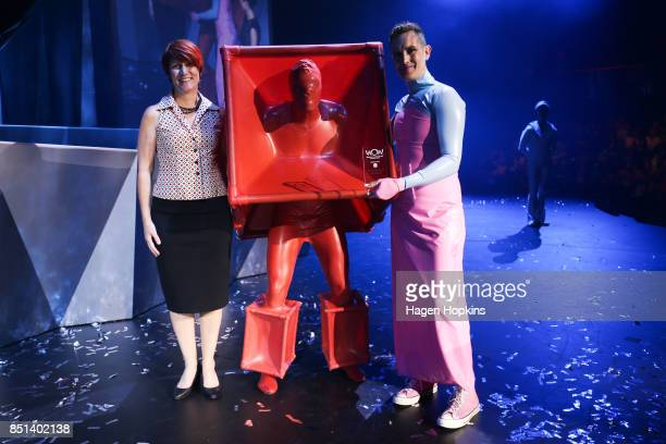 Adam McAlavey of the United Kingdom poses with his creation 'Cube' after winning the Cirque du Soleil Invited Artisan Award during the World of...