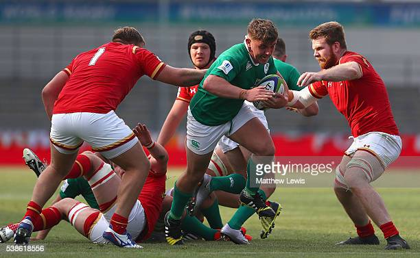 Adam McBurney of Ireland breaks through the Wales defence during the World Rugby U20 Championship match between Wales and Ireand at The Academy...