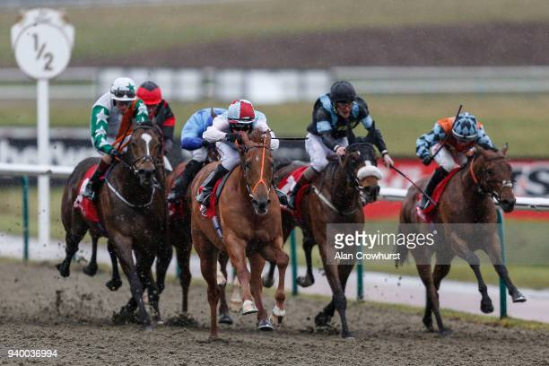 Adam McNamara riding Take The Helm win The Sunbets AllWeather Championships Apprentice Handicap Stakes at Lingfield Park on March 30 2018 in...
