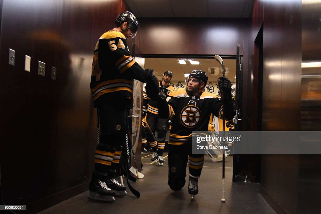 Adam McQuaid #54 and Jake DeBrusk #74 of the Boston Bruins fist bump before warm ups before the game against the Tampa Bay Lightning in Game Three of the Eastern Conference Second Round during the 2018 NHL Stanley Cup Playoffs at the TD Garden on May 2, 2018 in Boston, Massachusetts.