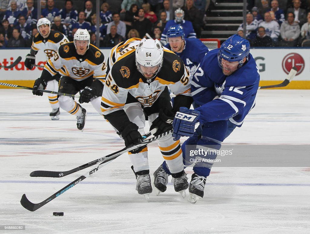 Adam McQuaid #54 of the Boston Bruins battles against Patrick Marleau #12 of the Toronto Maple Leafs in Game Four of the Eastern Conference First Round in the 2018 Stanley Cup play-offs at the Air Canada Centre on April 19, 2018 in Toronto, Ontario, Canada. The Bruins defeated the Maple Leafs 3-1.
