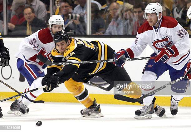 Adam McQuaid of the Boston Bruins battles Yannick Weber of the Montreal Canadienst in Game Seven of the Eastern Conference Quarterfinals during the...